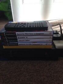 PS2 + 5 games and memory card.