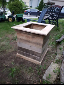 "Wooden ""beehive"" planter boxes"