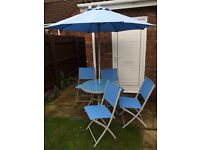 Patio table, parasol and 4 chairs
