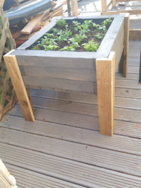 Solid wood planters with legs made from recycled wood