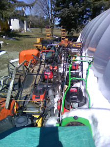 Selection of used lawnmowers good for parts , handyman projects.