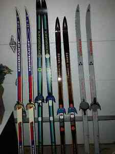 Assorted X-country skis, poles and boots