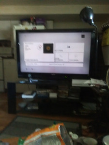 "Tv sony bravia. 1080 lcd  55"" with tinted Glass stand"