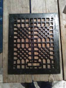 Vintage cast iron decorative grate