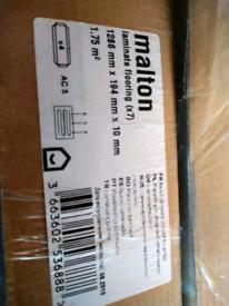 Malton oak laminate flooring, £20 for both pks.