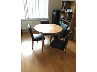 Round oak laminate dining table and 4x faux leather brown chairs