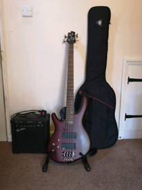 Left handed Cort bass guitar and accessories