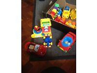 Young children's car selection box with a variety of different cars and figures