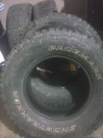 two Studded 255 70 16 Snow Tracker tires