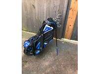 Child's golf clubs with bag