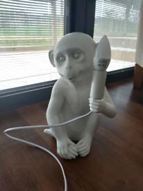 Gorgeous white monkey light table lamp