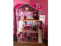 Big pink wooden doll house