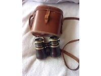 Very old , with case .. Lens triple optic
