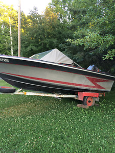 Grew motor boat with trailer
