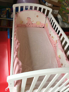 Baby crib with clean mattress and cover