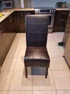 4 brown leather chairs / 4 chaise en currently brun West Island Greater Montréal image 1