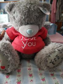 Large tatty teddy bear