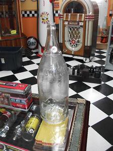 Grosse bouteille JUMBO original 60 oz. très bonne condition.