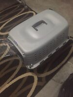 Small plastic dog crate