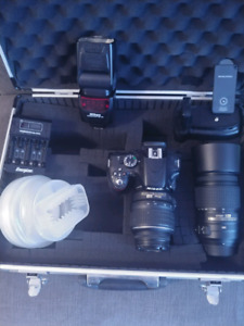 Nikon D5100 with 18-55 mm lens + 55-300mm