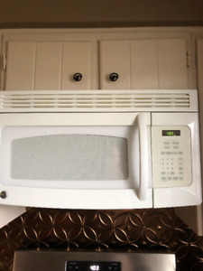 Fridge, gas stove, above stove microwave