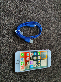 Iphone 6s, with charger cable.