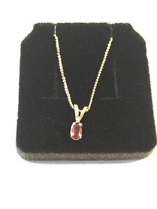 "10k 20"" Yellow Gold Chain and 10k Garnet Pendant"