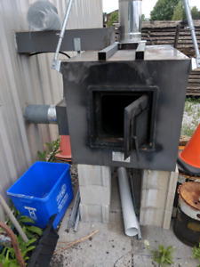 Outdoor wood stove and stainless pipe