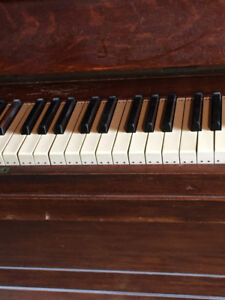 Piano - Antique and Classic looking Wooden Piano.