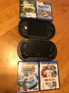 PS Vita PCH-1000 with games, adapter & 4GB memory card