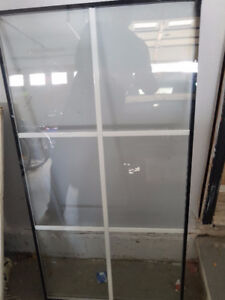 Glass window with grills