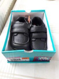 Boy brand new smart shoes