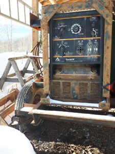 225 Arc Welder 2 Cylinder Onan.  Comes with 40 ft. cables