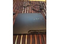 160 GB PS3 Slim with 26 games and 2 controllers