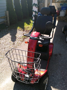 Burgundy 4 wheel scooter