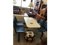 Cafe table with fitted chairs