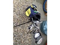 Dunlop golf bag with selection of clubs balls and T's