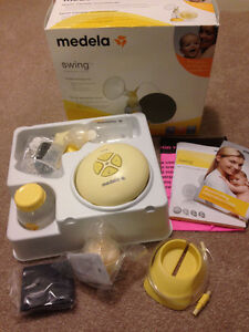 Medela Swing Breast Pump: Basically new. Lucky you.