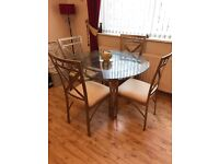 Gold and cream glass dining table & chairs