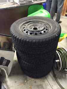 Kumho studded winter tires and rims 215/60R16