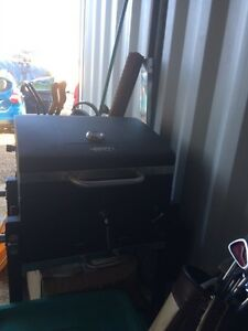 Charcoal bbq with all the tools to bbq /elect lawn mower