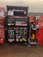 Snap on toolbox full of tools and blue point roll cart