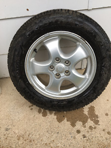 215/60R16   4 Winter Tires With Rims off Ford 2005 Ford Taurus.