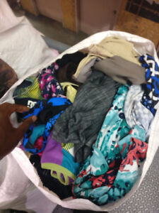 Wholesale clothing in bags for retailers.