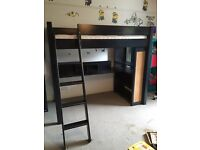 Loft bed and mattress with desk and bookshelves