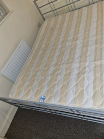 14. Metal double bed frame and mattress