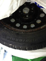 175/65/r14 14 inch studded winter tires on rims, 1 season only