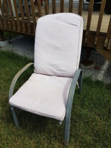 4 reclining patio chairs  with foot stool.  No cushions