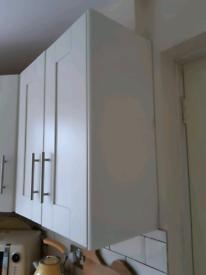 Clad on ivory kitchen unit wall panel.