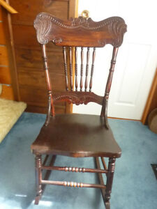 Pretty pressed back rocking chair, solid condition